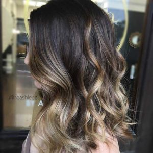 Light and shine for your dark hair with blonde highlights!