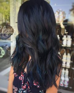 Dark brown hair with blue highlights