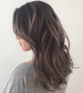Medium brown hair with silver highlights