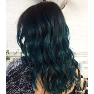 Black hair can, if possible, look even better with teal highlights