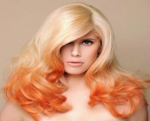 Blonde hair with orange highlights