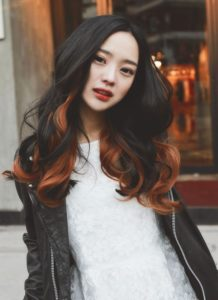 Orange highlights on black hair