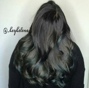 bright colored teal highlights on chocolate brown hair