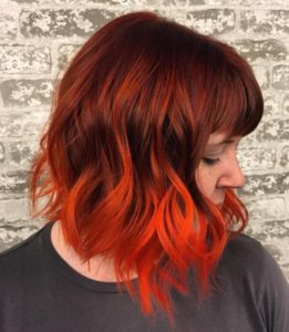 It would surprise you how orange highlights can enhance your beauty